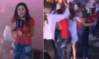 Nữ phóng viên bị xé nát quần áo khi đang lên hình trực tiếp