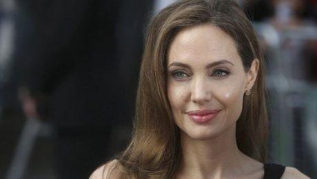Angelina Jolie nguoi phu nu dung cam va lam chu cuoc song - Anh 11