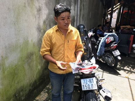 Nhom hiep si truy bat doi tuong giat 200 to ve so cua nguoi ngheo - Anh 1