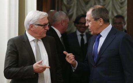 Ngoai truong Nga va nguoi dong cap Duc dien dam ve Syria - Anh 1