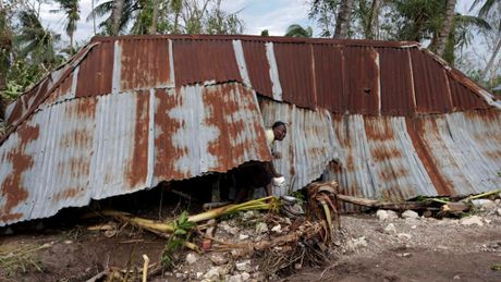 Haiti lam vao tinh trang khung hoang sau bao Matthew - Anh 2