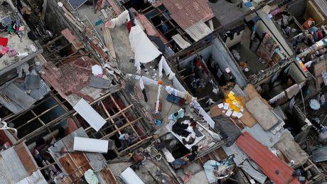 Haiti lam vao tinh trang khung hoang sau bao Matthew - Anh 4