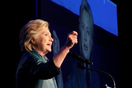 Clinton dan Trump 5 diem truoc them cuoc tranh luan thu hai - Anh 1