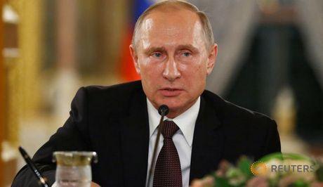 Tong thong Nga Putin bat ngo huy tham Phap - Anh 1