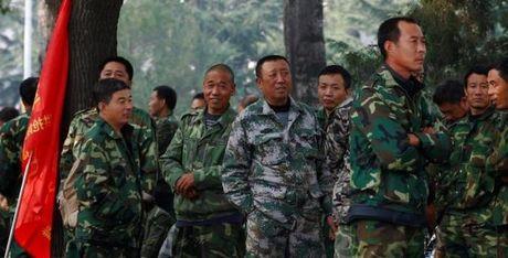 Bao quan doi TQ canh bao the luc chong lai cai cach cua ong Tap - Anh 1