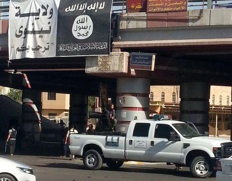 Kinh hoang: IS xu tu 58 nguoi am muu noi day o Mosul - Anh 1