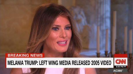 Vo Donald Trump len tieng benh vuc chong ve 'video khiem nha' - Anh 1