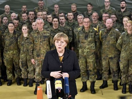 Duc se tang manh ngan sach quoc phong theo yeu cau cua NATO - Anh 1